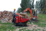 hinowa-tracked-minidumper-tracked-minidumper-hs1103-during-the-loading-of-stones-1075825-FGR